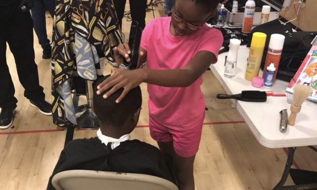 8-year-old girl passes barber training, gives back to community with free haircuts
