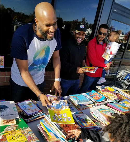 This Organization, Ran By 6 Black Men, Has Donated More Than 30,000 Books to Children Worldwide – But They Need More Volunteers and Financial Support