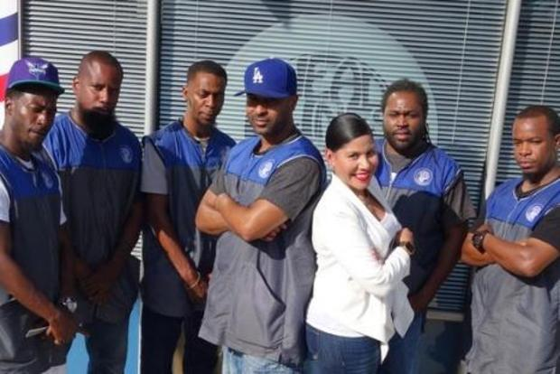 Barbershop owner raises funds to pay off high school seniors' debts so they can graduate